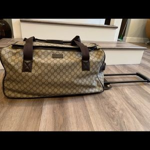 Gucci tolling duffel carry-on bag